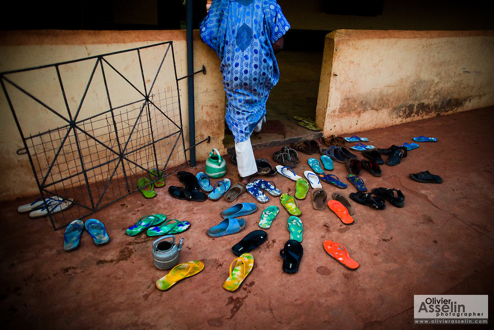 A man leaves his sandals outside as he enters a mosque in Tamale, northern Ghana on Tuesday March 24, 2009.