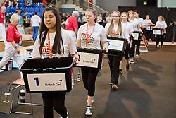 Volunteers bringing swim buckets to start line  at 2015 IPC Swimming World Championships -