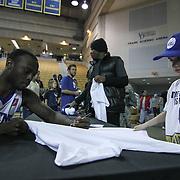Delaware 87ers Guard isa (12) signs a autograph for a young fan following a 115-88 NBA D-league regular season lost to the Idaho Stampede Thursday, Dec. 12, 2013 at The Bob Carpenter Sports Convocation Center, Newark, DE