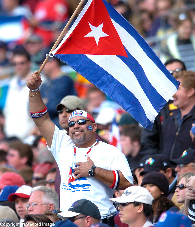Team Cuba fans waves the flag in the 8th inning against Team Dominican Republic in Semi-Final action of the World Baseball Classic at PETCO Park, San Diego, CA.