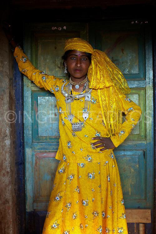 Gypsie girl posing in a doorway.