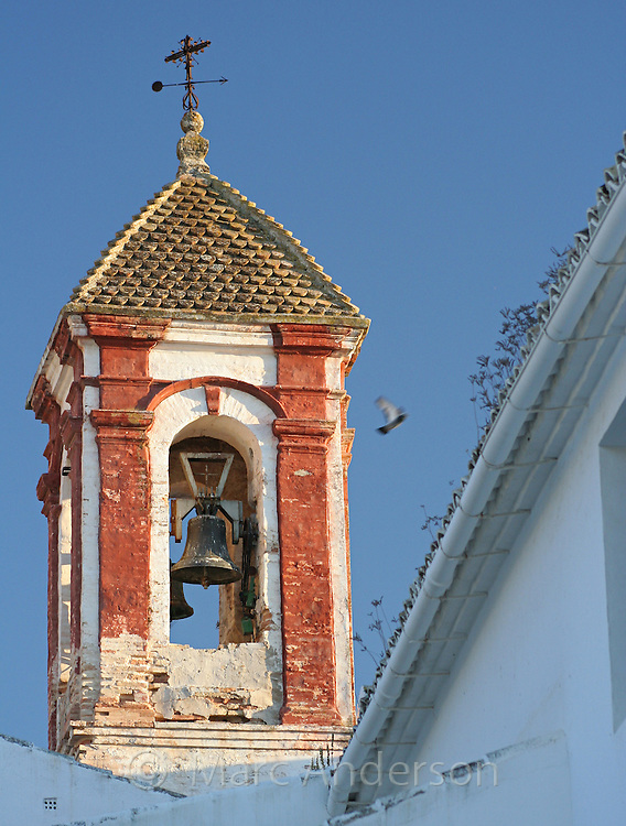 Old church bell tower in Zuheros, a Spanish white village in Andalucia, Spain