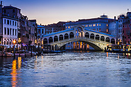 Dawn at Rialto Bridge in Venice Italy.  If you get up early enough a peacefulness comes to this city of canals