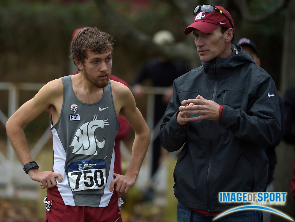 Nov 21, 2015; Louisville, KY, USA; Washington State Cougars coach Wayne Phipps (right) talks with Michael Williams (750) during the 2015 NCAA cross country championships at Tom Sawyer Park.