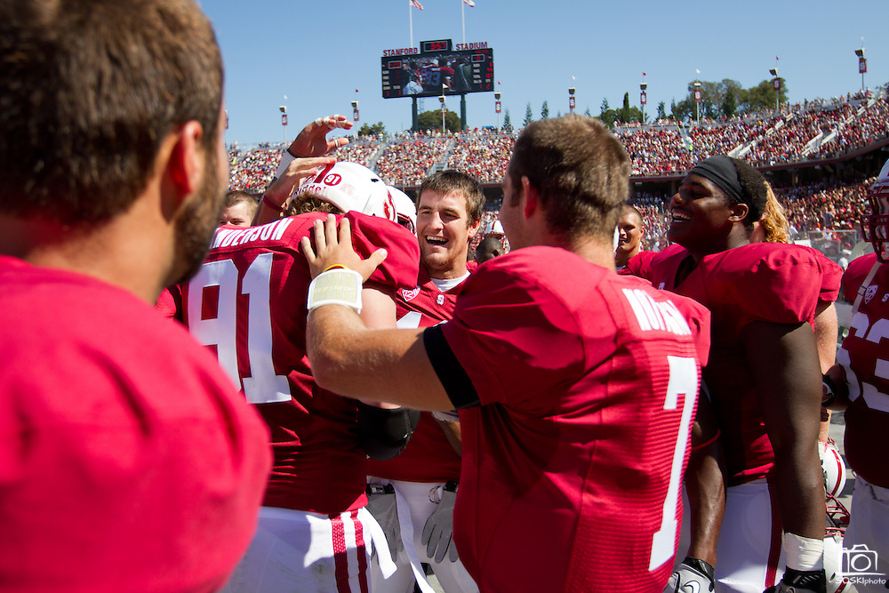 Stanford University Cardinals' Henry Anderson (91) receives praise on the sidelines after returning a San Jose State fumble to the 1 yard line, Palo Alto, Calif., Sept. 3, 2011.  Stanford (7) beat San Jose State 57-3.  (Spartan Daily/Stan Olszewski)