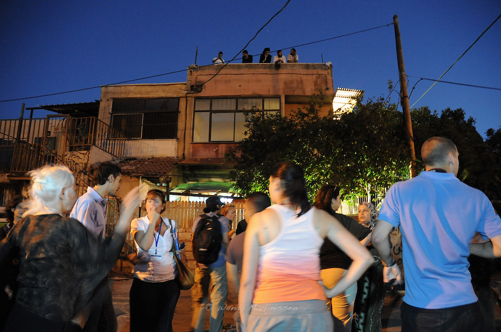Jewish settlers that are occupying the Ghawi family home, look on from the roof at the UN delegation visiting the families in Sheikh Jarrah, who were recently evicted from their homes in this East Jerusalem neighbourhood.