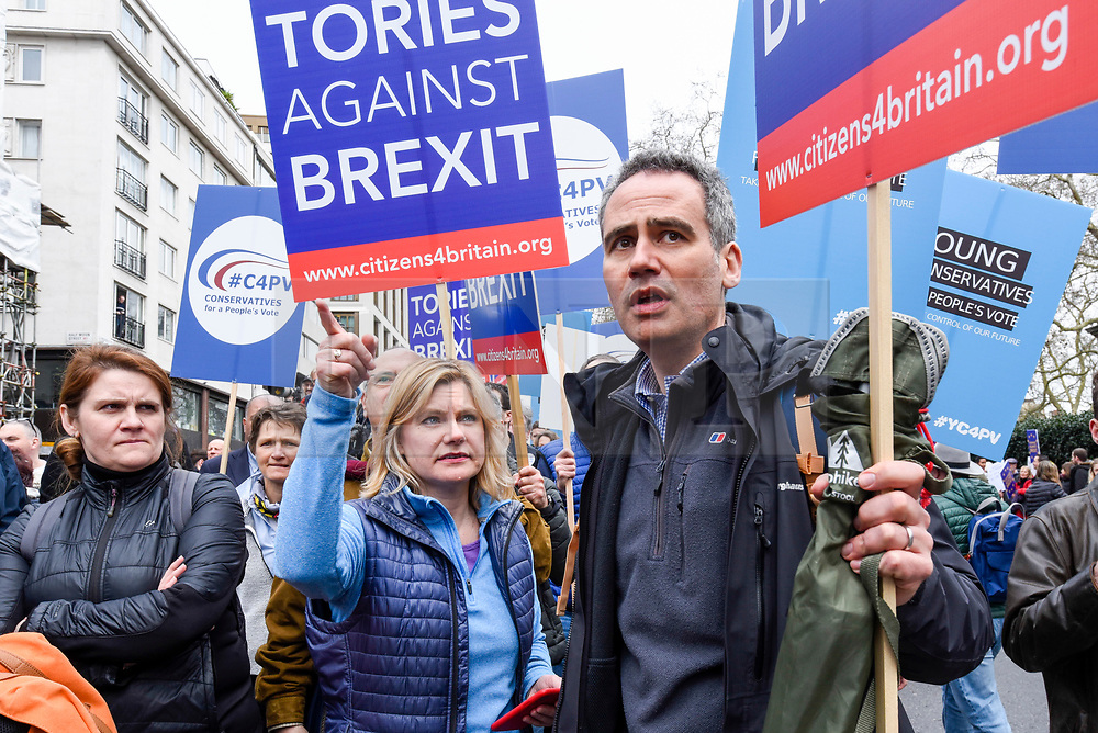 """© Licensed to London News Pictures. 23/03/2019. LONDON, UK. Justine Greening (C), MP for Putney, takes part in the march. Thousands of people take part in the """"Put It To The People March"""", marching from Park Lane to Parliament Square on what was supposed to be six days before the UK was due to leave the EU, before an extension to the departure date was given.  Protesters demand that the public is given a final say on Brexit as support for the Prime Minister's withdrawal plan continues to recede.  Photo credit: Stephen Chung/LNP"""
