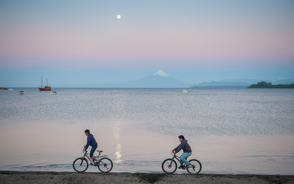 Two Cyclists on Beach, Puerto Varas, Chile