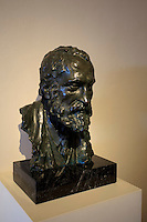 A bust of famous architect Antoni Gaudi on display within his former home, now a museum, in the grounds of Park Guell, Barcelona, Spain