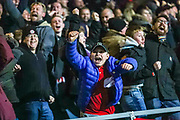 Brentford fans celebrate the third Brentford goal during the EFL Sky Bet Championship match between Queens Park Rangers and Brentford at the Kiyan Prince Foundation Stadium, London, England on 28 October 2019.
