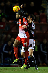 Leyton Orient Forward Yohann Lasimant (FRA) is challenged by Bristol City Midfielder Marlon Pack (ENG) - Photo mandatory by-line: Rogan Thomson/JMP - 07966 386802 - 11/02/2014 - SPORT - FOOTBALL - The Matchroom Stadium, London - Leyton Orient v Bristol City - Sky Bet Football League 1.