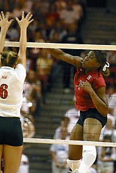 Stanford's Ogonna NNamani returns the ball past the outstreched arms of ISU's Kelly Rikli during explosive competion. The game and set was won by Stanford.  The match up took place at ISU's Redbird Arena in Normal Illinois on September 11, 2002.  The crowd was over 5600 and took the record for fans attending a volleyball game at Redbird, the MVC's record for number of fans watching a conference team and was the largest audience in the continental US thus far in the 2002 season<br />