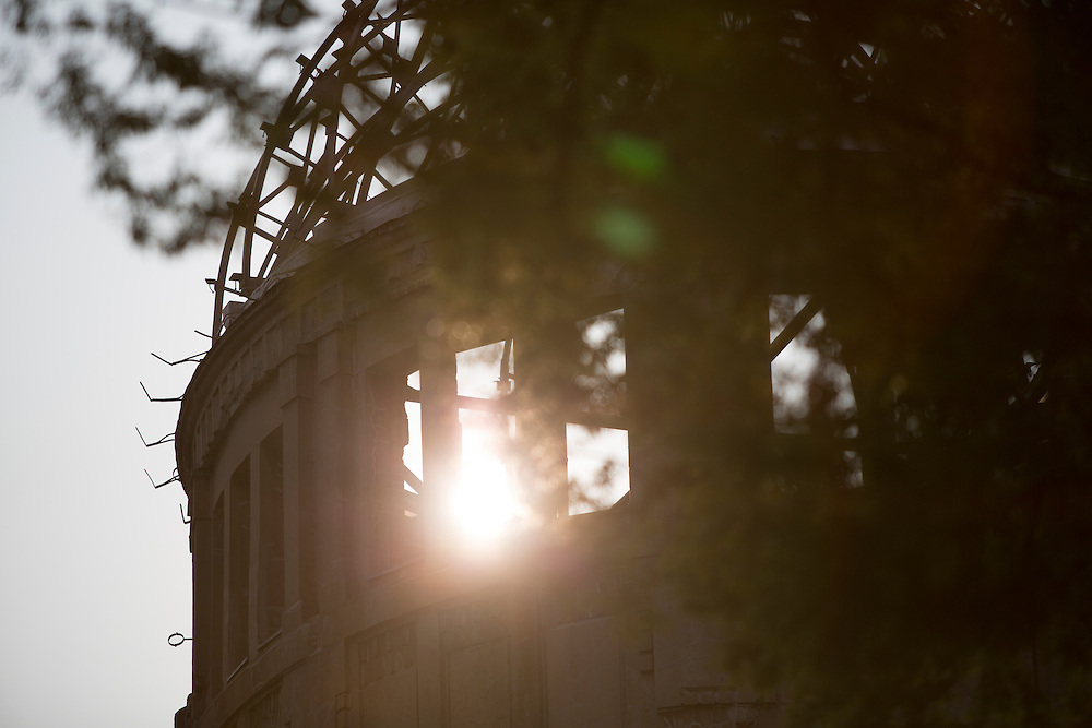 HIROSHIMA, JAPAN - AUGUST 4 : The Atomic Bomb Dome is seen at sunset in the Hiroshima Peace Memorial Park two days prior to 71st anniversary of the bombing in Hiroshima, western Japan, Thursday, August 4, 2016. The Genbaku Dome also known as the Atomic Bomb Dome is now a symbol for peace within the Hiroshima Peace Memorial Park. The building was one of the few left standing when the first atomic bomb 'Little Boy' was dropped by the United States from the Enola Gay on August 6, 1945. (Photo: Richard Atrero de Guzman/NURPhoto)