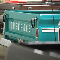 The tailgate of 1966 Chevy pick-up owned by Buddy Palmer is lined up with the other trucks that are on display at the Tupelo Automobile Museum during the classic truck exhibit that runs until September 30.