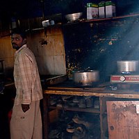 Communal kitchen where workers take turn to prepare their meals.