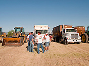 31 JULY 2009 --  BUCKEYE, AZ: Bidders look at equipment for sale at the auction on the former Pylman Dairy Farm in Buckeye. The auction was handled by Overland Stockyards from Hanford, CA. The Arizona dairy industry is struggling to survive the worst milk economy some have ever seen. Due to the global recession, overseas demand for Arizona dairy products has plummeted, forcing prices down while production costs have stayed stable or gone up. For every $1 dairymen earn from milk sales, it cost them $1.50 to produce the milk. Photo by Jack Kurtz