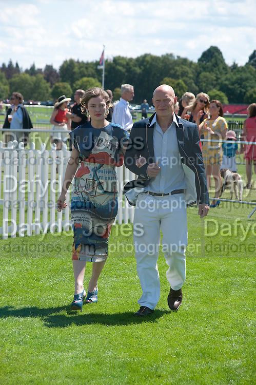 CAMILLA RUTHERFORD; DOMINIC BURNS, Cartier International Polo. Smiths Lawn. Windsor. 24 July 2011. <br /> <br />  , -DO NOT ARCHIVE-© Copyright Photograph by Dafydd Jones. 248 Clapham Rd. London SW9 0PZ. Tel 0207 820 0771. www.dafjones.com.