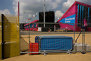 Landscape of the Riverbank Arena, venue for the Hockey, invested in the Olympic Park during the London 2012 Olympics but also as future venue for the general public - its purpose undecided. Fencing and barriers protect this secure area during a Hockey game is played and spectators line the seating out of sight. This land was transformed to become a 2.5 Sq Km sporting complex, once industrial businesses and now the venue of eight venues including the main arena, Aquatics Centre and Velodrome plus the athletes' Olympic Village. After the Olympics, the park is to be known as Queen Elizabeth Olympic Park.