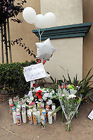 A shrine at the site of Tuesday's officer-involved shooting near the Sanborn Plaza Market at the corner of Del Monte Avenue and North Sanborn Road in Salinas.