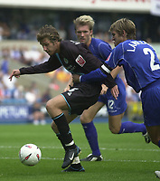 Photo:Alan Crowhurst.Millwall v Leicester City 14/08/04 Coca-Cola Championship.Gareth Williams escapes from Matt Lawrence.