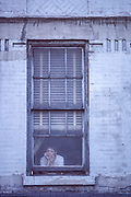 Lonely Window, Woman in window, New York City, New York, USA, May 1985