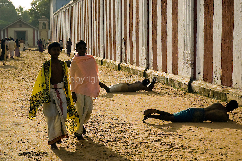 Nallur Festival. Jaffna. Penitents roll around the outside of the temple wall in fullfilment of a vow.