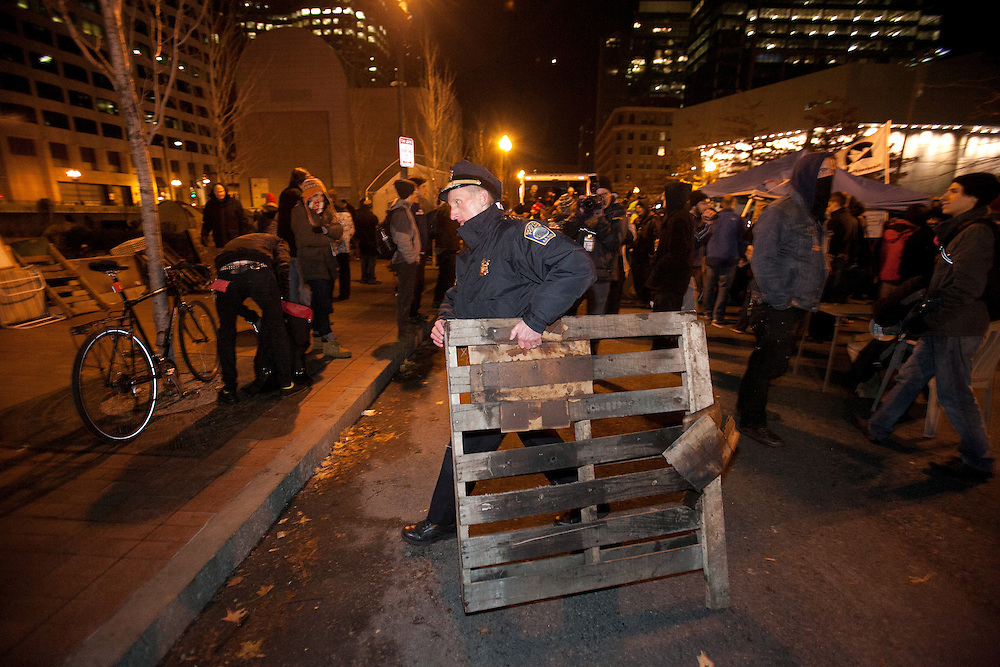 Boston, MA 12/09/2011.Boston Police Superintendent William Evans carries a wooden pallet out of Atlantic Avenue early Friday morning..Alex Jones / www.alexjonesphoto.com