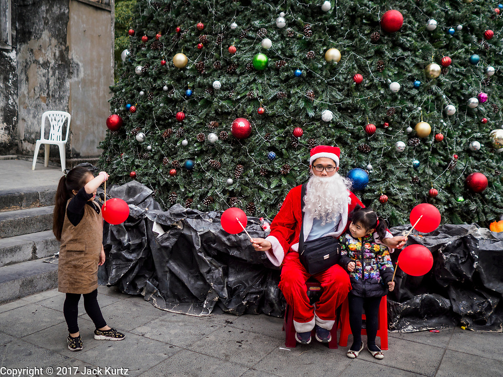 25 DECEMBER 2017 - HANOI, VIETNAM: A Santa Claus in front of St Joseph's Cathedral in Hanoi.     PHOTO BY JACK KURTZ