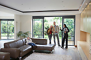 Parents with bored daughter (7-9) and estate agent observing new property