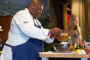 Former Top Chef contestant Ron Duprat provides a culinary demonstration at the Grand Market during the Atlantic City Food & Wine Festival.