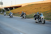 A group of Christian Motorcycle Association riders pull out of south OKC on their way to a local motorcycle event.