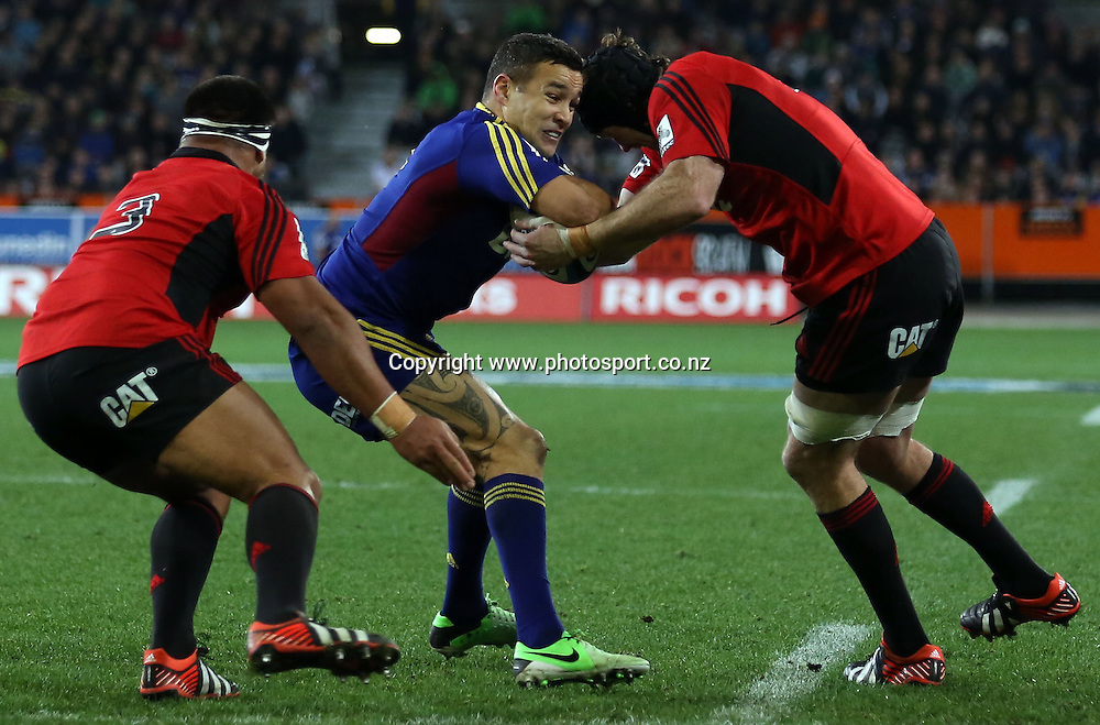Tamati Ellison of the Highlanders attempts to break the tackle of Tom Donnelly.<br /> Super Rugby - Highlanders v Crusaders, 29 June 2013, Forsyth Barr Stadium, Dunedin, New Zealand.<br /> Photo: Rob Jefferies / photosport.co.nz