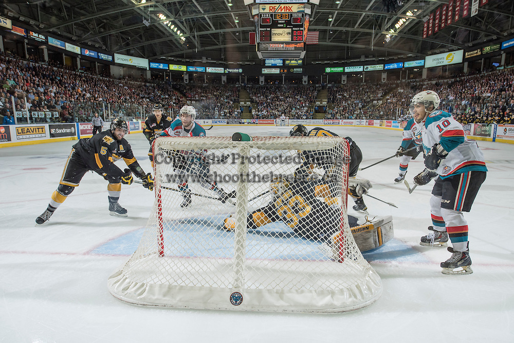 KELOWNA, CANADA - MAY 11: Jordan Papirny #33 of Brandon Wheat Kings makes a save against the Kelowna Rockets on May 11, 2015 during game 3 of the WHL final series at Prospera Place in Kelowna, British Columbia, Canada.  (Photo by Marissa Baecker/Shoot the Breeze)  *** Local Caption *** Jordan Papirny;