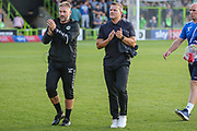Forest Green Rovers assistant manager, Scott Lindsey and Forest Green Rovers manager, Mark Cooper applaud the crowd during the EFL Sky Bet League 2 match between Forest Green Rovers and Stevenage at the New Lawn, Forest Green, United Kingdom on 21 August 2018.