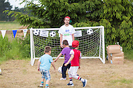 20140601 Free for editorial use image<br /> <br /> Halifax colleagues in Bournemouth are proud to give extra back to their local community by hosting their Big Lunch event on Sunday 01 June 2014.<br /> <br /> Three boys try to beat the goalie during The Big Lunch at the New Leaf Allotment in Bournemouth. <br /> <br /> For more information please contact: Catherine Eastham on 020 3697 4304<br /> <br /> If you require a higher resolution image or you have any other onEdition photographic enquiries, please contact onEdition on 0845 900 2 900 or email info@onEdition.com<br /> This image is copyright the onEdition 2014&copy;.<br /> This image has been supplied by onEdition and must be credited onEdition. The author is asserting his full Moral rights in relation to the publication of this image. Rights for onward transmission of any image or file is not granted or implied. Changing or deleting Copyright information is illegal as specified in the Copyright, Design and Patents Act 1988. If you are in any way unsure of your right to publish this image please contact onEdition on 0845 900 2 900 or email info@onEdition.com