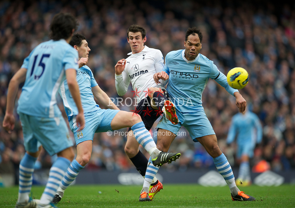 MANCHESTER, ENGLAND - Sunday, January 22, 2011: Manchester City's Joleon Lescott in action against Tottenham Hotspur's Gareth Bale during the Premiership match at the City of Manchester Stadium. (Pic by David Rawcliffe/Propaganda)