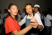 GOBI DESERT, MONGOLIA..08/26/2001.Bayangovi. Discotheque..(Photo by Heimo Aga).