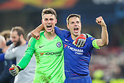 Chelsea goalkeeper Kepa Arrizabalaga (1) and Chelsea defender Cesar Azpilicueta (28) celebrate after their team's 4-3 win on penalties during the Europa League semi final second leg match between Chelsea and Eintracht Frankfurt at Stamford Bridge, London, England on 9 May 2019.