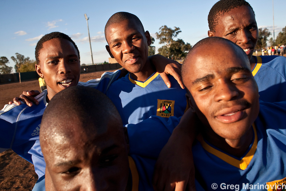 Sharpeville Mohloli secondary school has the best soccer team in Gauteng province, despite veing from an impoverished area with little or no facilities. Siphiwe Vilakazi is one of the stars of the team, but beofre a match against a rivl school he had to walk across the township trying to borrow a pair of boots to play in as his brother had to use the family pair of boots. May 7 2010. The match was played in the shadow of the George Thabe stadium where Cote Ivoire will practice during the World Cup, but the locals play on a sand field, strewn with rocks. Photo Greg Marinovich / Storytaxi.com