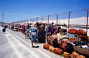 A line of souvenir craft stalls as people walk to the cruise ship terminal, Tangier, Morocco, north Africa 1999