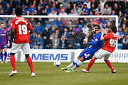 Gillingham defender Max Ehmer looks to release the ball ahead of Coventry midfielder Jodi Jones during the Sky Bet League 1 match between Gillingham and Coventry City at the MEMS Priestfield Stadium, Gillingham, England on 2 April 2016. Photo by David Charbit.