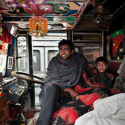 Group of drivers sitting inside the truck during winter.