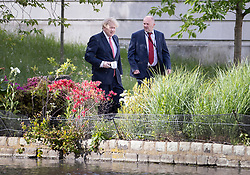 © Licensed to London News Pictures. 11/05/2020. London, UK. Prime Minister Boris Johnson walks in St James's Park near Buckingham Palace in central London. The Prime Minister has announced a few changes to the lockdown rules. Photo credit: Peter Macdiarmid/LNP