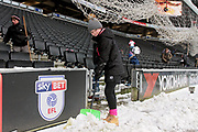 A young MK Dons fan helping to clear the snow before the EFL Sky Bet League 1 match between Milton Keynes Dons and Bristol Rovers at stadium:mk, Milton Keynes, England on 3 March 2018. Picture by Nigel Cole.
