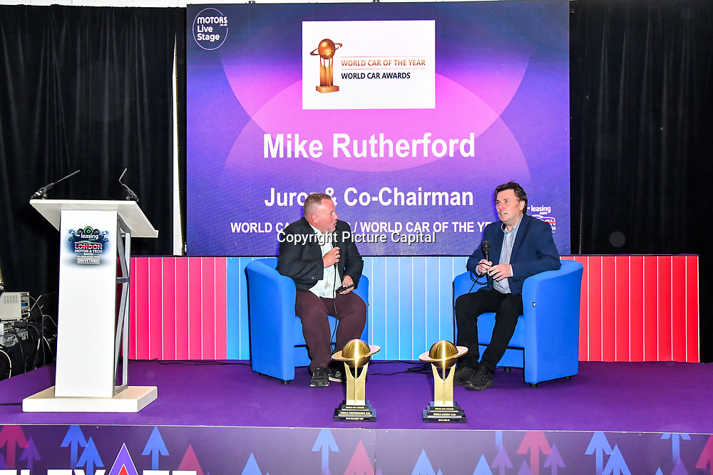Speaker Mike Rutherford (R) at the London Motor & Tech Show‎ opening day on 16 May 2019, at Excel London, UK.