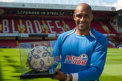 Brian Deane Who scored the very first FA Premier League Goal for Sheffield United at Bramhall Lane Sheffield against Manchester United 25 years ago today with ball he used to score it<br /> <br /> 15 August 2017 <br />   Copyright Paul David Drabble<br />   www.pauldaviddrabble.co.uk