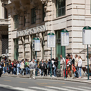 People waiting at bus stop on Via Del Corso, Rome, Italy