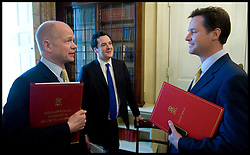 Deputy Prime Minister Nick Clegg talks to First Secretary of State, Secretary of State for Foreign and Commonwealth Affairs William Hague (L) and Chancellor of the Exchequer George Osborne in the Cabinet room.  Photo By Andrew Parsons/i-Images