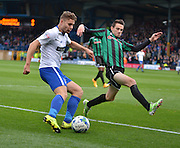 Bury Defender Joe Riley crosses into the box past a diving Rochdale Midfielder, Peter Vincenti during the Sky Bet League 1 match between Bury and Rochdale at Gigg Lane, Bury, England on 17 October 2015. Photo by Mark Pollitt.