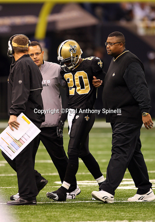 NEW ORLEANS - DECEMBER 07: Cornerback Randall Gay #20 of the New Orleans Saints gets helped off the field after an injury during the game against the Atlanta Falcons at the Louisiana Superdome on December 7, 2008 in New Orleans, Louisiana. The Saints defeated the Falcons 29-25. ©Paul Anthony Spinelli *** Local Caption *** Randall Gay